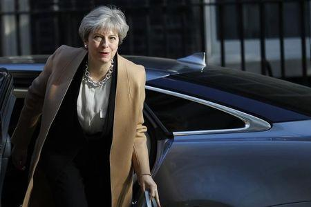 Britain's Prime Minister Theresa May arrives in Downing Street, in central London