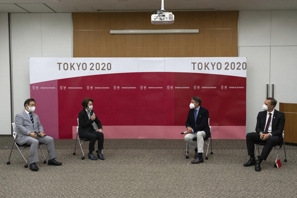 Toshiaki Endo, left, vice president of the Tokyo 2020 Organizing Committee, Seiko Hashimoto, center left, president of the Tokyo 2020 Organizing Committee, Sebastian Coe, center right, president of World Athletics and John Ridgeon, World Athletics CEO, attend a meeting Friday, May 7, 2021 in Tokyo, Japan. Hashimoto said Friday that a planned visit to Japan this month by IOC President Thomas Bach seemed unlikely with a state of emergency order being extended by the government to Tokyo and other areas until May 31.(Carl Court/Pool Photo via AP)