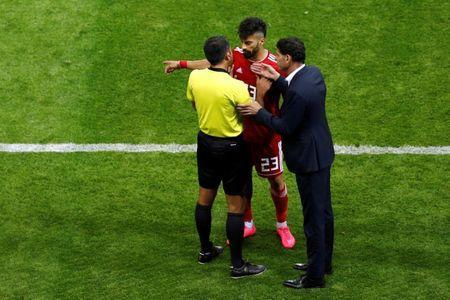Soccer Football - World Cup - Group B - Iran vs Spain - Kazan Arena, Kazan, Russia - June 20, 2018 Iran's Ramin Rezaeian and Spain coach Fernando Hierro speak with a match official REUTERS/John Sibley