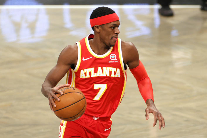 Rajon Rondo #7 of the Atlanta Hawks dribbles during the first half against the Brooklyn Nets at Barclays Center on December 30, 2020 in the Brooklyn borough of New York City. NOTE TO USER: User expressly acknowledges and agrees that, by downloading and/or using this Photograph, user is consenting to the terms and conditions of the Getty Images License Agreement. (Photo by Sarah Stier/Getty Images)