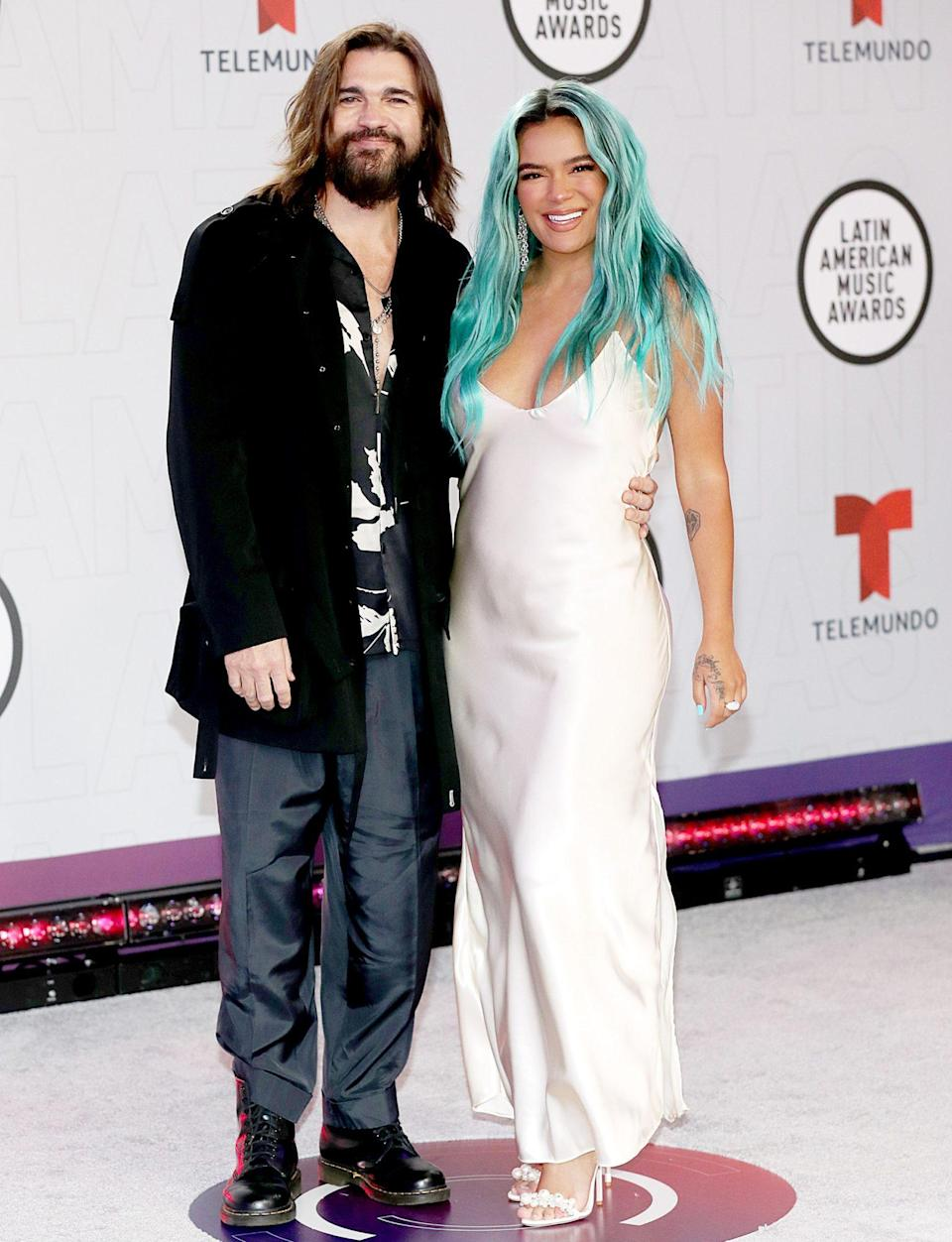 <p>Juanes and Karol G step out onto the red carpet for the Latin American Music Awards on Thursday in Sunrise, Florida. </p>