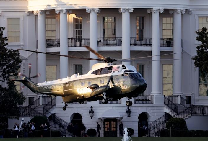 "Marine One, the presidential helicopter, carries President Donald Trump away from the White House on the way to Walter Reed National Military Medical Center on Friday. Trump and First Lady Melania Trump have tested positive for coronavirus. <span class=""copyright"">(Win McNamee / Getty Images)</span>"