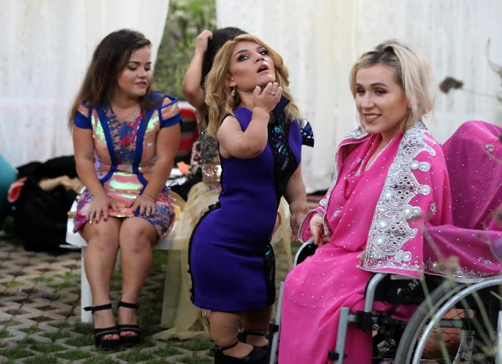 Models gather backstage at the International Dwarf Fashion Show on May 20, 2017 in Dubai (AFP Photo/KARIM SAHIB)