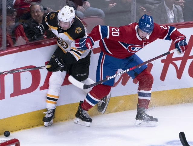 Montreal Canadiens' Cale Fleury, right, fends off Boston Bruins' Zach Senyshyn during the second period of an NHL hockey game Tuesday, Nov. 5, 2019, in Montreal. (Paul Chiasson/The Canadian Press via AP)