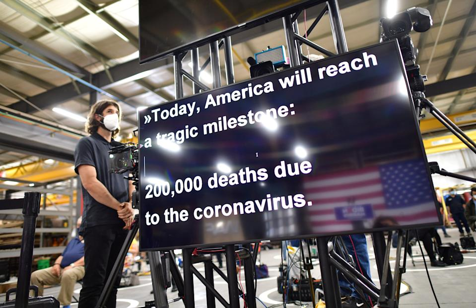 Joe Biden's teleprompter refers to the death toll from the coronavirus disease (COVID-19) outbreak in the United States exceeding 200,000 people as he speaks during a campaign event at the Wisconsin Aluminum Foundry in Manitowoc, Wisconsin, U.S., September 21, 2020.  (Mark Makela/Reuters)