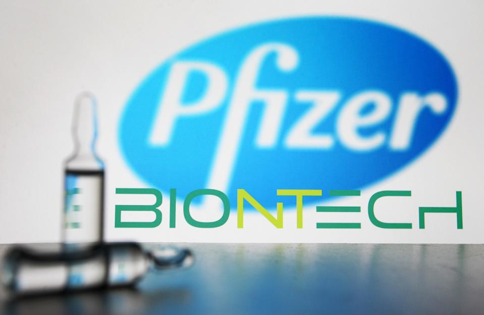 In this photo illustration ampules seen in front of American multinational pharmaceutical corporation Pfizer and German biotechnology company Biontech logos. (Photo by Pavlo Gonchar / SOPA Images/Sipa USA)