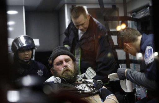 <p>A protester from Occupy Oakland receives medical attention in an ambulance after being arrested on January 28. Riot police fired tear gas and arrested more than 400 people in Oakland, California, as hordes of anti-Wall Street protesters tried to take over downtown buildings including City Hall, police said.</p>