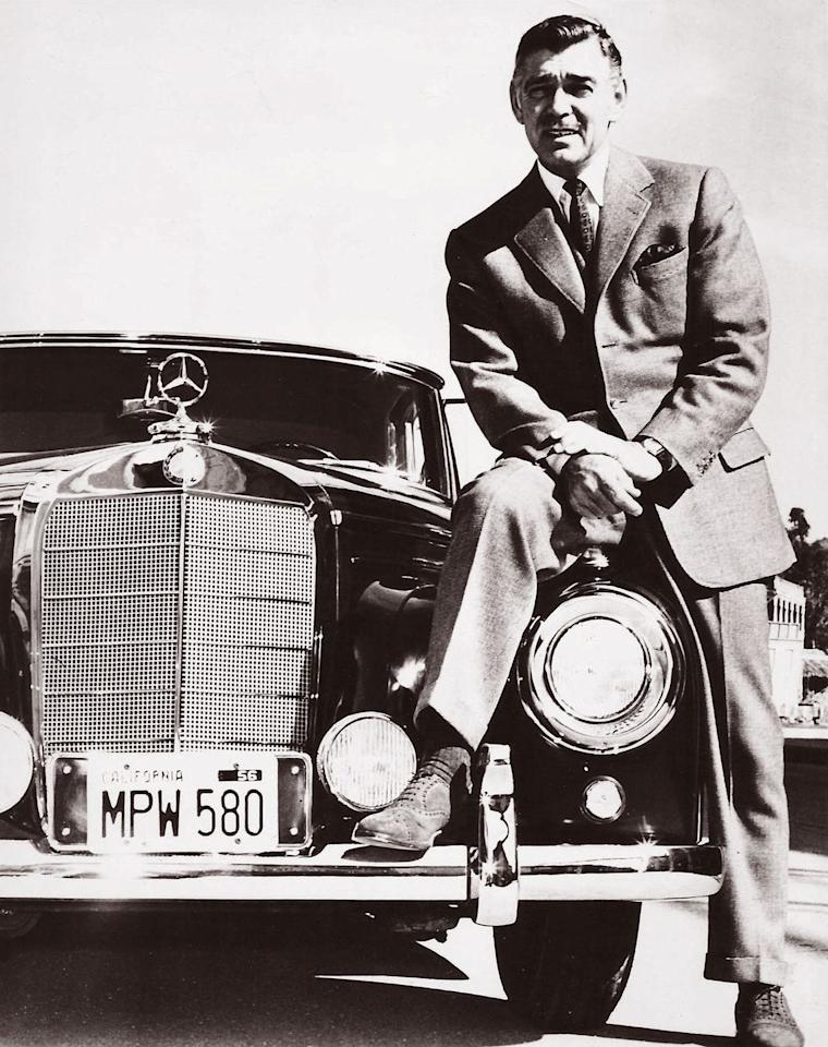 <p>Gable sits on his 1955 Mercedes-Benz 300 SL. </p>