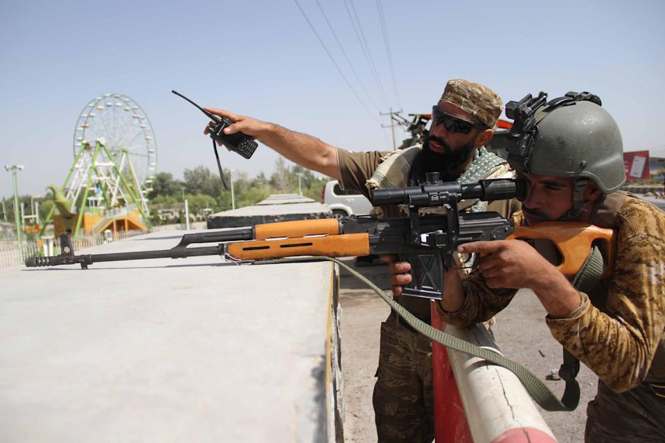 Security officials at a roadside check point in Herat, one of three Afghan cities that could fall to the Taliban (EPA)