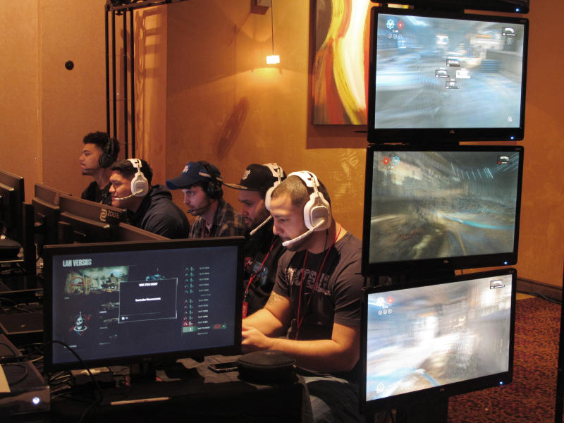 FILE - In this March 31, 2017, file photo, video game players compete against one another in an esports tournament at Caesars casino in Atlantic City, N.J. The commissioner of the Esports Integrity Coalition says skill-based betting on battle royale games like Fortnite and PlayerUnknown's Battleground could be vulnerable to cheating. Esports gambling website Unikrn announced plans last month to bring legal skill-based betting to the U.S., allowing users to wager on themselves in games like Fortnite and PlayerUnknown's Battleground. Users would link their game to the Unikrn platform, and Unikrn will generate odds for the player based on his or her profile within the game. ESIC Commissioner Ian Smith says such wagering is likely to be popular, but he's concerned the industry is not yet prepared to govern it.  (AP Photo/Wayne Parry, File)