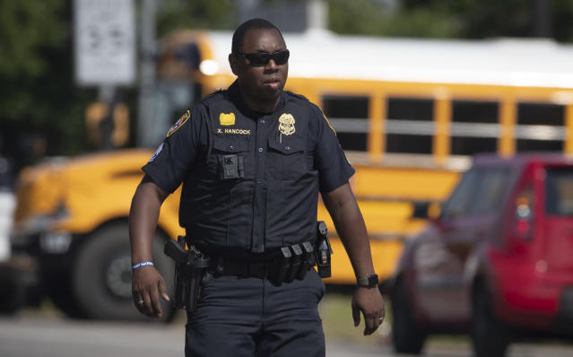 <p>Galveston Police officer Xavier Hancock works at the scene of a shooting at Santa Fe High School on Friday, May 18, 2018, in Santa Fe, Texas. (Photo: Stuart Villanueva /The Galveston County Daily News via AP) </p>