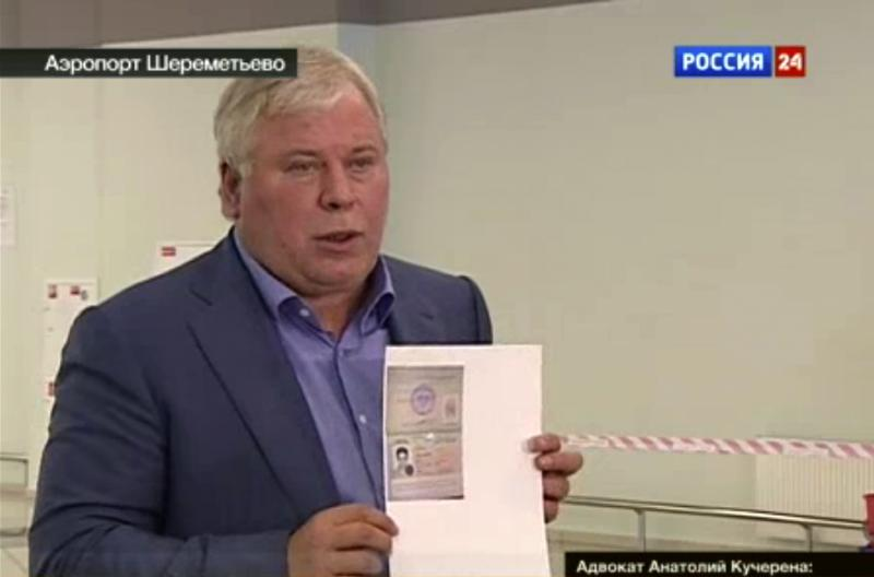 In this image taken form Russia24 TV channel, Russian lawyer Anatoly Kucherena shows a temporary document to allow Edward Snowden cross the border into Russia while speaking to the media after visiting National Security Agency leaker Edward Snowden at Sheremetyevo airport outside Moscow, Russia. National Security Agency leaker Edward Snowden has received asylum in Russia for one year and left the transit zone of Moscow' airport, his lawyer said Thursday. Kucherena said after meeting with the fugitive at Moscow's Sheremetyevo airport, where he was stuck since his arrival from Hong Kong on June 23, that he handed him the papers proving his status. Kucherena said that Snowden's whereabouts will be kept secret for security reasons. (AP Photo/Russia24 via APTN) TV OUT
