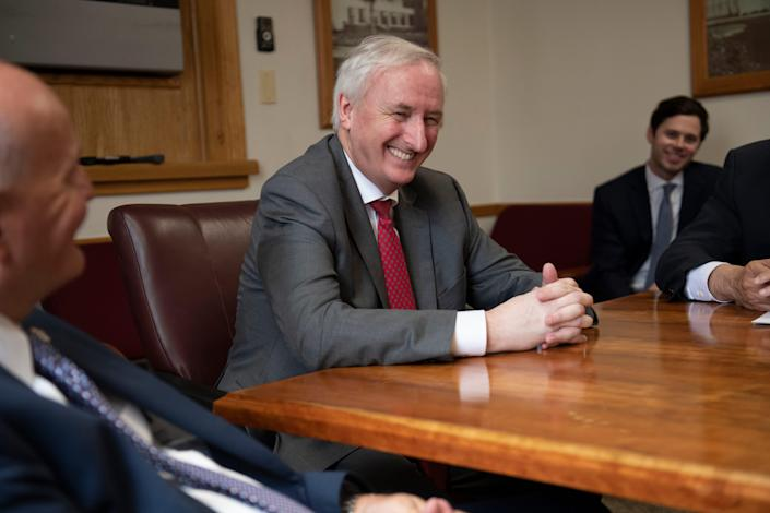 Deputy Attorney General Jeffrey Rosen smiles while meeting with other officials after the completion of a tour of the Englewood Federal Correctional Institution in Colorado