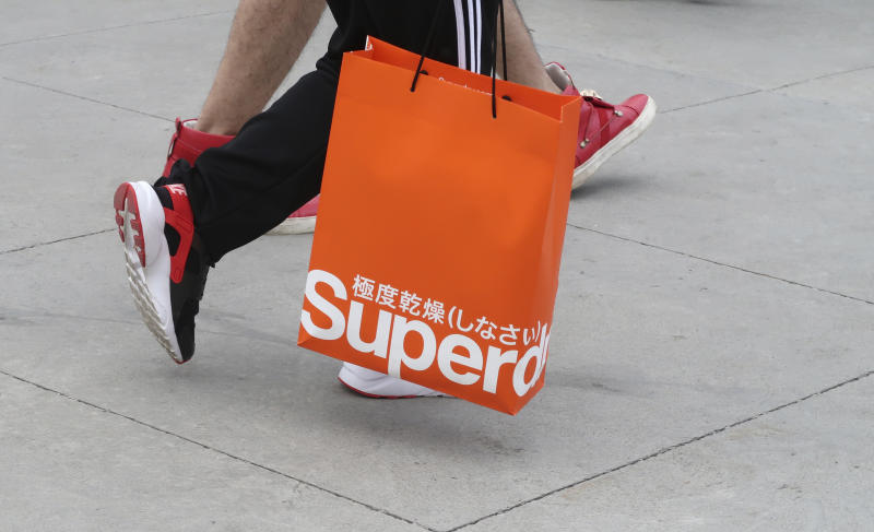 CENTRAL VALLEY, NY - AUGUST 26: A person carries a bag from the Superdry store at the Woodbury Common Premium Outlets shopping mall on August 26, 2018 in Central Valley, New York. (Photo by Gary Hershorn/Getty Images)