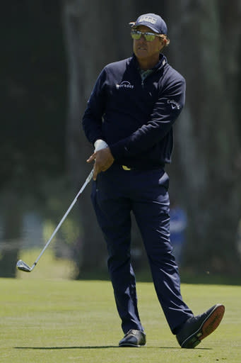 Phil Mickelson hits from the fairway on the ninth hole during the second round of the PGA Championship golf tournament at TPC Harding Park Friday, Aug. 7, 2020, in San Francisco. (AP Photo/Charlie Riedel)