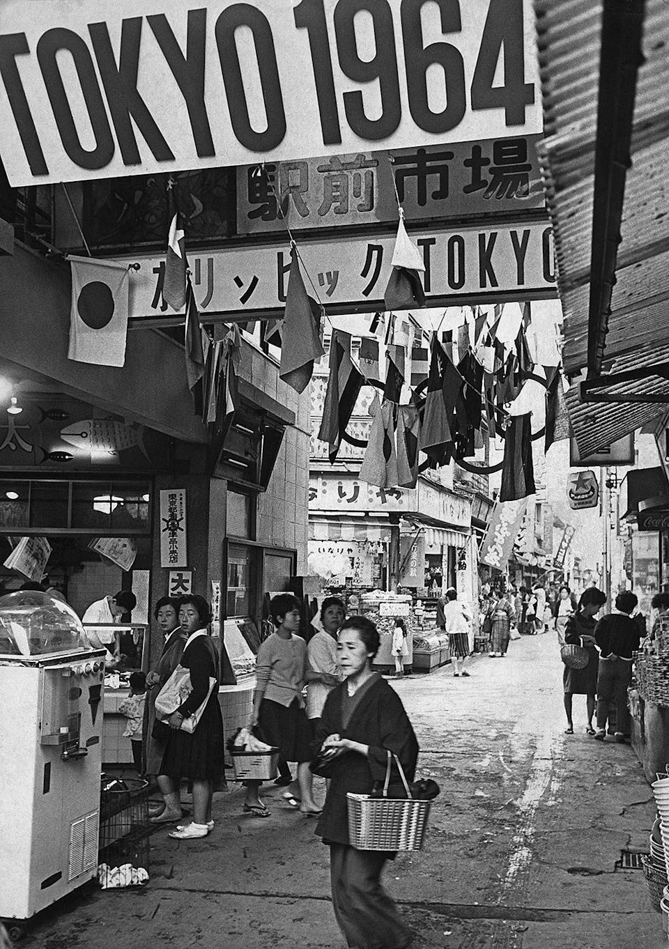 <p>The city and its residents are seen preparing for the 1964 Olympics in Tokyo.</p>
