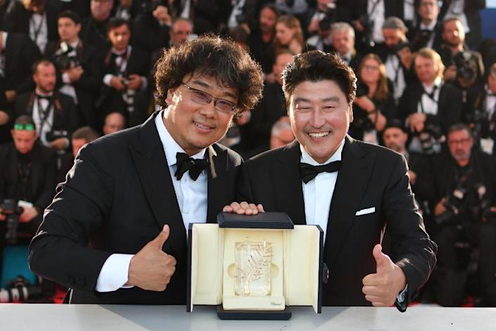 Bong Joon-Ho (l): 'I rely on Song a lot' (AFP Photo/Alberto PIZZOLI)