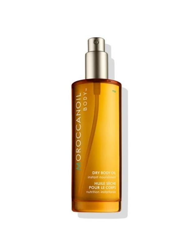"<p><strong>Moroccanoil Dry Body Oil, $48, <a href=""https://shop-links.co/1707433992363659425"" rel=""nofollow noopener"" target=""_blank"" data-ylk=""slk:available here"" class=""link rapid-noclick-resp"">available here</a>: </strong>""It was the scent of this oil that first drew me in — musky and sweet, with a hint of orange blossom — but the fast-absorbing, non-greasy formula and easy-to-use mist-on applicator solidified my obsession."" —Stephanie Saltzman, Beauty Director</p>"