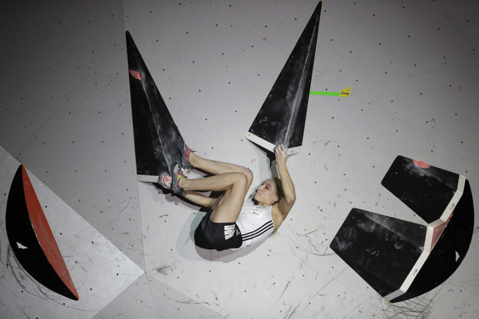 FILE - Janja Garnbret, of Slovenia, competes during the women's combined bouldering final at the International Federation of Sport Climbing World Championships in Tokyo, in this Aug. 20, 2019, file photo. Climbing has always been a niche sport among outdoor enthusiasts. Inclusion in the 2021 Tokyo Olympics will take it mainstream and the world will see just how difficult it is clinging to tiny hand holds with fingers and toes. (AP Photo/Jae C. Hong, File)
