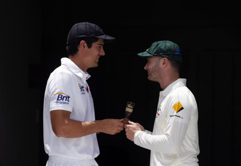Australia's cricket team captain Michael Clarke (R) holds a replica Ashes urn with England's team captain Alastair Cook at the Gabba cricket ground in Brisbane November 20, 2013. England and Australia will play for the Ashes in a five-test match series starting in Brisbane on November 21. REUTERS/David Gray (AUSTRALIA - Tags: SPORT CRICKET)