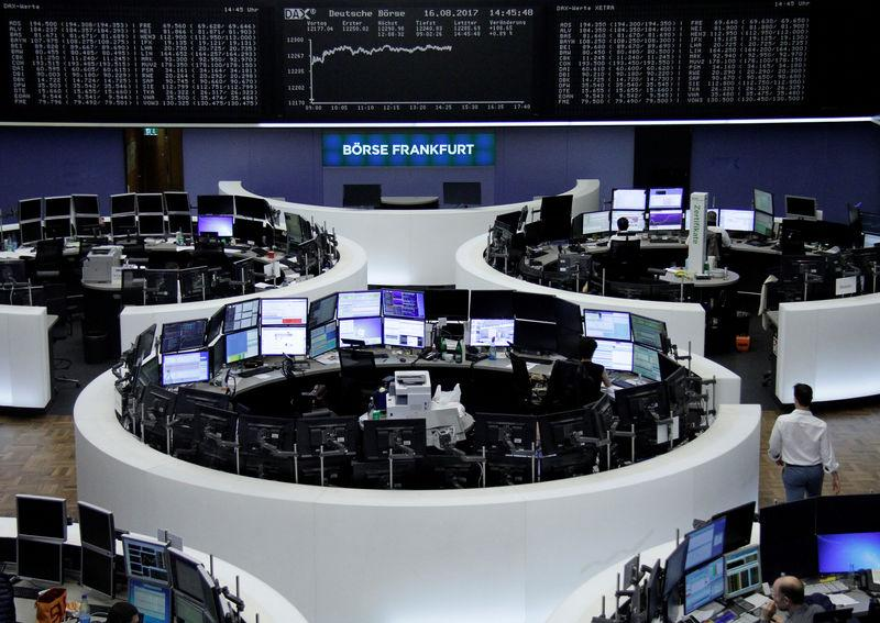 Traders work in front of the German share price index, DAX board, at the stock exchange in Frankfurt, Germany, August 16, 2017. REUTERS/Staff/Remote