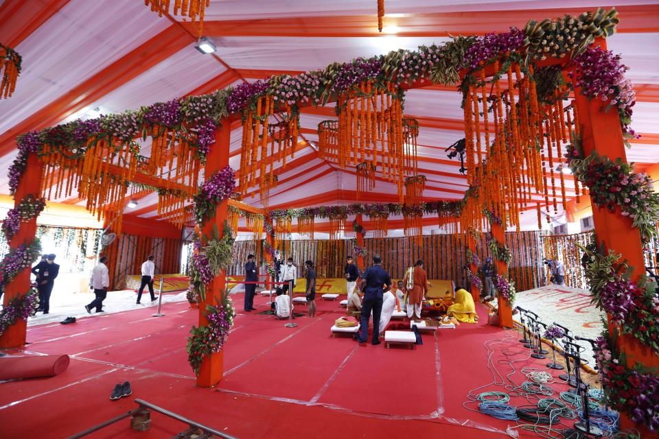 Hindu priests prepare the site for a groundbreaking ceremony of a temple dedicated to the Hindu god Ram in Ayodhya, India, Wednesday, Aug. 5, 2020. The coronavirus is restricting a large crowd, but Hindus were joyful before Prime Minister Narendra Modi breaks ground Wednesday on a long-awaited temple of their most revered god Ram at the site of a demolished 16th century mosque in northern India. (AP Photo/Rajesh Kumar Singh)