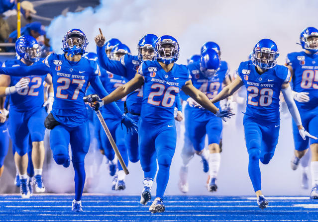 Boise State Broncos players run onto the field before a game against New Mexico on Nov. 16, 2019. (Douglas Stringer/Getty Images)