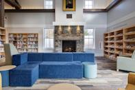 """<p>With a roaring fireplace and a calming color palate, the <a href=""""http://mclvt.org"""" rel=""""nofollow noopener"""" target=""""_blank"""" data-ylk=""""slk:Manchester Community Library"""" class=""""link rapid-noclick-resp"""">Manchester Community Library</a> exudes coziness and serenity in Vermont's Green Mountain region.<br></p>"""