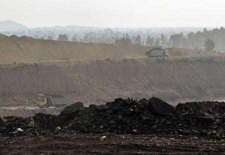 Trucks carrying coal are pictured at Magadh coal mine in Chatra district in the eastern state of Jharkhand, India, September 30, 2015. REUTERS/Stringer