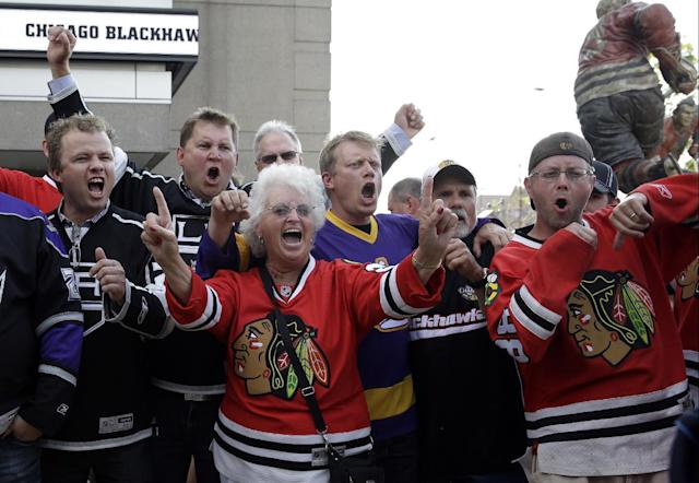 Fans cheer as they arrive at United Center before Game 7 of the Western Conference finals in the NHL hockey Stanley Cup playoffs between the Chicago Blackhawks and the Los Angeles Kings, Sunday, June 1, 2014, in Chicago. (AP Photo/Nam Y. Huh)