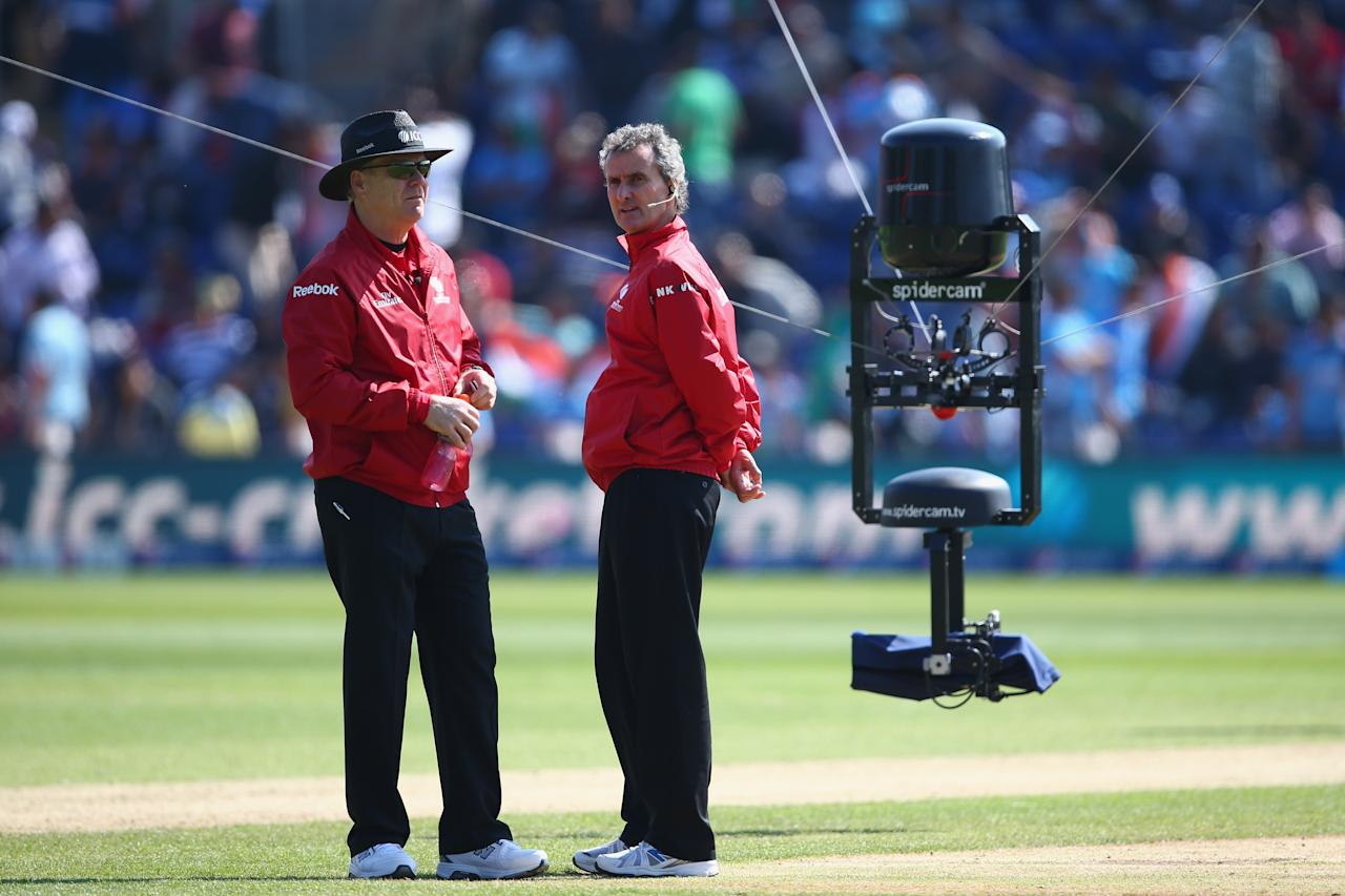 CARDIFF, WALES - JUNE 06: Umpires Bruce Oxenford (L) and Billy Bowden (R) are tracked by the spidercam during the Group B ICC Champions Trophy match between India and South Africa at the SWALEC Stadium on June 6, 2013 in Cardiff, Wales.  (Photo by Michael Steele/Getty Images)