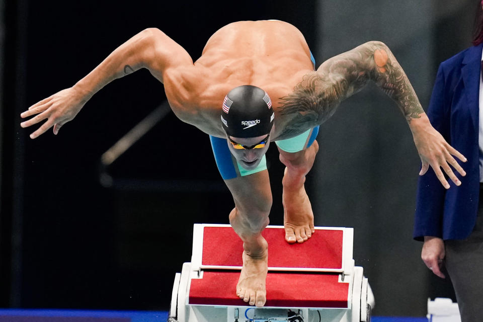 Caeleb Dressel, of United States, swims in a men's 100-meter butterfly semifinal at the 2020 Summer Olympics, Friday, July 30, 2021, in Tokyo, Japan. (AP Photo/Gregory Bull)