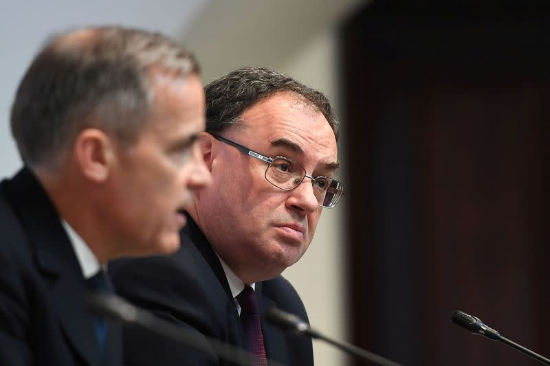 Mark Carney, Governor of Band of England and Andrew Bailey, Governor-designate of BOE, attend a news conference at Bank Of England in London