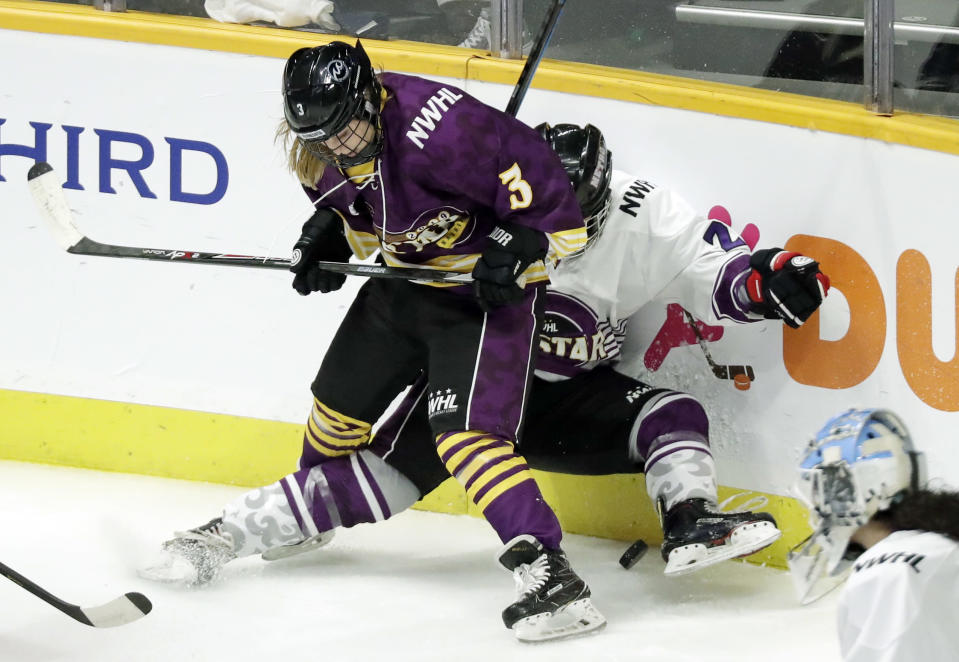 "FILE- In this Feb. 10, 2019, file photo, Jonna Curtis, left, a forward on Team Stecklein, battles for the puck with Michelle Picard, right, a defender on Team Szabados, during the NWHL All-Star Hockey Game in Nashville, Tenn. The women's hockey league thinks it can make it work with the same kind of COVID-19 testing the NBA used in its Disney World bubble. Players, coaches and staff will essentially be limited to hotel and Herb Brooks Arena, the site of the 1980 ""Miracle on Ice"" that serves as a historic setting for a unique season. (AP Photo/Mark Humphrey, File)"