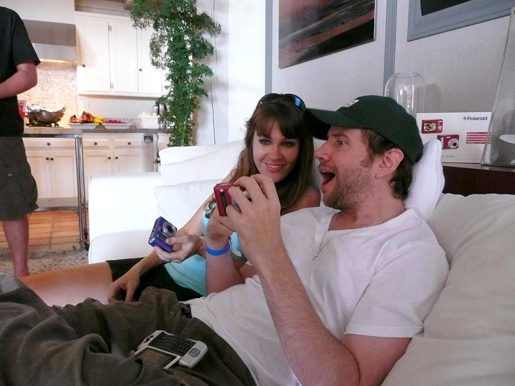 Comedian Jamie Kennedy jokes around while flipping through some digital pics with a friend. omg! staff/Polaroid Malibu Beach House - July 23, 2007