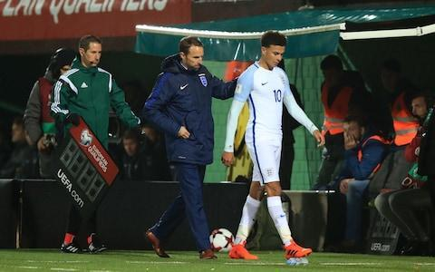 "Dele Alli believes England's Euro 2016 humiliation left him and his team-mates bruised, battered, but stronger and ready to restore the country's pride at this summer's World Cup. The European Championships were Dele's first experience of an international tournament and he admits the elimination to Iceland was one of the worst moments of his short career so far. But Dele, as he has been known since changing the name on the back of his shirt in 2016, is now confident he and England will benefit from their bad experience in France when they travel to Russia. With England now on countdown to the World Cup and due to face Holland and Italy in pre-tournament friendlies, Dele said: ""The Euros was one of the best experiences of my career and one of the worst at the same time. But everything's a new experience and you learn from it all. ""To be a part of it for your country, growing up you see the big tournaments being played, you see it on the TV, look at all the flags flying out of the windows and seeing how much it means to the country, to be a part of it was massive but the way it ended was a huge disappointment. England's European Championships ended in disappointment Credit: PA ""As a team, it would have been quite easy to hide, not to look back on it and get it out of your memory, but it was important that we went through it so it doesn't happen again. I think as a team and as individuals we're stronger from going through that."" Describing how failure with England affected him, Dele added: ""It was a very sad time for me, not just for me but for all of the players. We felt that we not only let our country down, but we let ourselves down as well. ""As soon as I came back to Tottenham, I spoke to the manager and spoke to the other boys. I knew we had to get on with it, keep improving, you can't let it drag you down, you have to look forward and do whatever you need to do to make it right."" Dele's close relationship with Mauricio Pochettino has been an important ingredient in his success at Spurs and he is similarly positive about the bond between him and England manager Gareth Southgate. ""Gareth is a great manager and a great person,"" said Dele. ""He's really nice and he's easy to talk to, which I think is important. When you are bringing in people from different clubs, it's important everyone gets along and he is really good at speaking to everyone. He's a great manager and it's a pleasure to play for him."" Dele Alli is a big fan of Gareth Southgate Credit: PA Under Southgate, England comfortably topped their World Cup qualifying group, winning eight of their 10 games, and Dele, who last week launched the Tottenham Hotspur Community Football League in Haringey, believes there is already proof the squad has improved since 2016. ""Yeah, I definitely think we've gained from it (the Euros),"" he said. ""You never know what will happen in a tournament, but as a team we feel stronger, we feel more together and we are learning from it. It's important that we learn from it together. ""We obviously don't get to spend that much time as an England squad, but we know the way we want to play and a lot of it is very similar to the way we play with our clubs."" England's World Cup 2018 squad - ranked. Who's on the plane to Russia? Dele has scored two goals in 22 appearances for England and, asked whether or not he believes he has replicated his Tottenham form at international level yet, said: ""It's different because at Tottenham you are training every day, you are playing, then you go to England and it's different players to what you are used to with your club. ""Everyone wants to play well for their country and maybe I haven't scored as many goals, but I'm still helping the team, still trying to get into the starting XI in every game."" Dele Alli accepts that he needs to score more goals Credit: GETTY IMAGES Still only 21, Dele is too young to remember any of the World Cups in which England have done well but the youngster is well aware how much a good performance in Russia would mean to the nation. On his World Cup memories, Dele said: ""Because I didn't watch too much football when I was younger, it wasn't so much the actual tournament but more like everybody wearing England shirts at school. ""I remember one time walking at the bottom of my estate. I was walking to the other end and England must have been playing because everyone was in their gardens, there was music playing and flags everywhere. That's just something in my head and to be part of an England team at a World Cup would be an amazing achievement for me. ""Everyone knows how big it is for the country and we are looking to make new memories and be part of something great. As players, it's important you don't forget where you come from and what you've done to get where you are, so I will definitely be thinking about how big it is."""