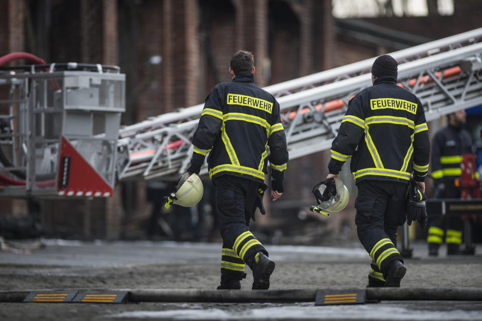 GOERLITZ, GERMANY - FEBRUARY 26: Firefighters are pictured the day after a big fire at an industrial hall on February 26, 2019 in Goerlitz, Germany. (Photo by Florian Gaertner/Photothek via Getty Images)