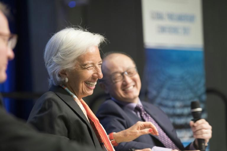 International Monetary Fund Managing Director Christine Lagarde (L) and World Bank President Jim Yong Kim (R) share a stage at the Parliamentary Town Hall at the IMF/World Bank Spring Meetings at the World Bank April 17, 2017 in Washington, DC