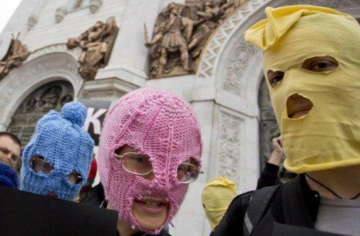 Supporters of punk group Pussy Riot wear coloured balaclavas in Moscow on August 15, 2012