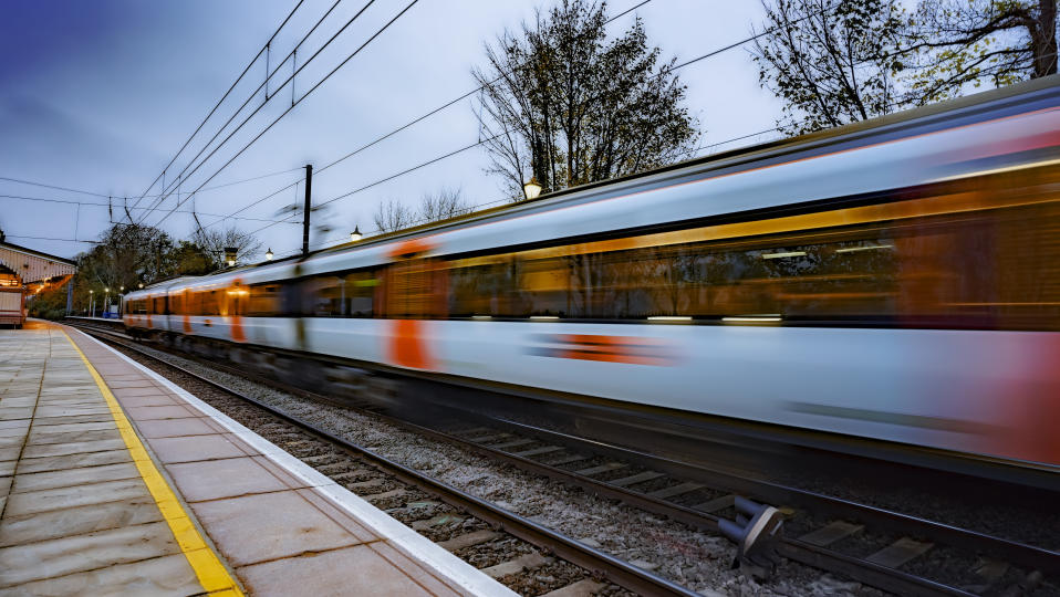 Commuter train departing a station and gathering speed