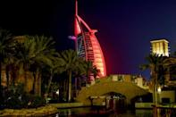 Landmarks across the UAE have been lit up in red at night and government accounts emblazoned with the #ArabstoMars hashtag