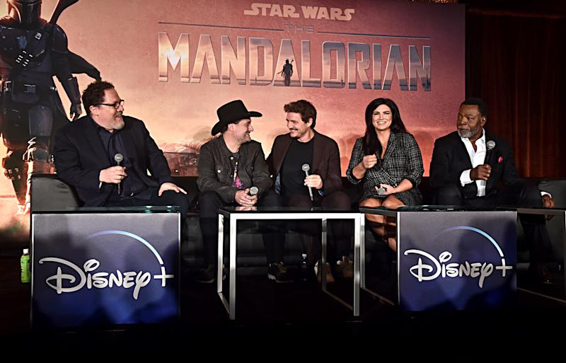 """WEST HOLLYWOOD, CALIFORNIA - OCTOBER 19: (L-R) Executive producers/writers Jon Favreau, Dave Filoni, actors Pedro Pascal, Gina Carano and Carl Weathers of Lucasfilm's """"The Mandalorian"""" at the Disney+ Global Press Day on October 19, 2019 in Los Angeles, California. """"The Mandalorian"""" series will stream exclusively on Disney+ when the service launches on November 12. (Photo by Alberto E. Rodriguez/Getty Images for Disney)"""