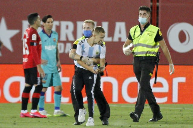 A fan managed to get into the stadium and invaded the pitch (Francisco Ubilla/AP)