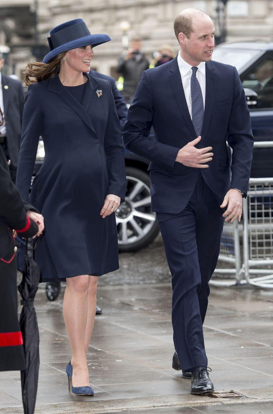 """<p>For the Commonwealth Day service, Duchess Kate chose a dark blue Beulah London dress and coat set paired with a Lock and Co hat. She and her soon-to-be sister-in-law Meghan Markle were both sporting <a href=""""https://www.townandcountrymag.com/society/tradition/a19407133/meghan-markle-outfit-commonwealth-day/"""" rel=""""nofollow noopener"""" target=""""_blank"""" data-ylk=""""slk:navy pointy-toe pumps"""" class=""""link rapid-noclick-resp"""">navy pointy-toe pumps</a> for the occasion. </p>"""