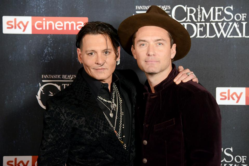LONDON, ENGLAND - NOVEMBER 13:  Johnny Depp (L) and Jude Law attend 'Fantastic Beasts: The Crimes Of Grindelwald' UK Premiere at Cineworld Leicester Square on November 13, 2018 in London, England. (Photo by Dave J Hogan/Dave J Hogan/Getty Images)