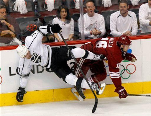 Phoenix Coyotes defenseman Rostislav Klesla, right, checks Los Angeles Kings center Jeff Carter (77) into the boards during the first period of Game 2 of the NHL hockey Stanley Cup Western Conference finals, Tuesday, May 15, 2012, in Glendale, Ariz. (AP Photo/Ross D. Franklin)