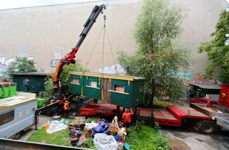 "A trailer from the closed club ""Pogo Tussy"" is moved to a truck at the club site in Berlin, Germany, September 5, 2016. After 13 years, ""Pogo Tussy"" is being torn down. The site will be used for residential apartments. REUTERS/Hannibal Hanschke"