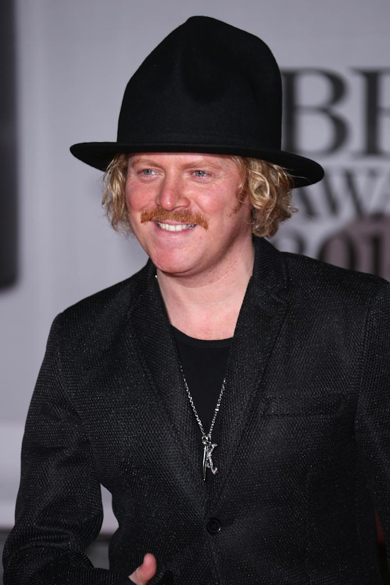 Leigh Francis arrives at the BRIT Awards 2014 at the O2 Arena in London on Wednesday, Feb. 19, 2014. (Photo by Joel Ryan/Invision/AP)