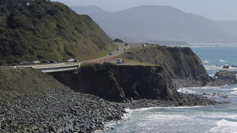 Investigators with the California Highway Patrol work at the scene where a couple and several of their children in their SUV plunged off. Source: AP