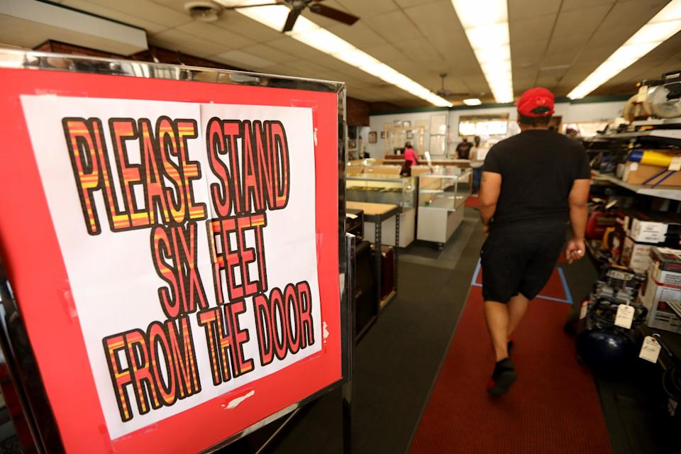 Social distancing signage greets customers at The Pawn Shop in downtown Atwater.